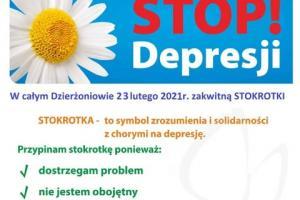 plakat ze stokrotką, symbolem walki z depresją. U góry napis Stop Depresji.